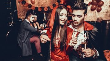 Young Couple Wearing Costumes Drinking Champagne | 13 DIY Couples Halloween Costumes: Why Buy When You Can Sew? | featured