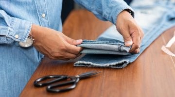 tailor working blue denim jeans hem | Genius Ideas In Hemming Pants | From First Stitch to Finished Piece | Featured