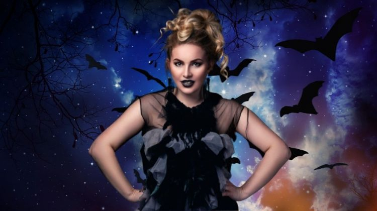 woman wearing a diy halloween costume with bats in the background | 10 DIY Plus Size Halloween Costumes You Can Sew | featured