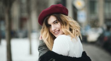 selective focus photography of smiling woman wearing red hat during snowy day | Winter Trends | Upcycling Ideas For Your Clothes & Fabric Scraps | Featured