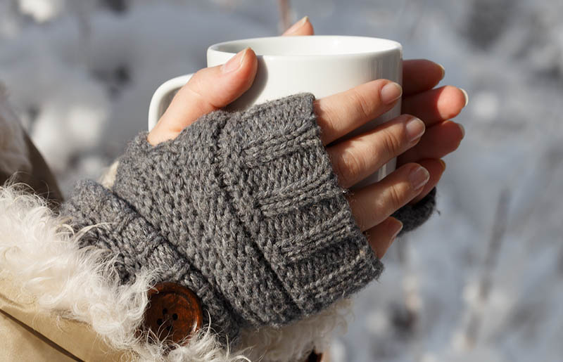 womens hands gray fingerless knitted mittens | winter trends