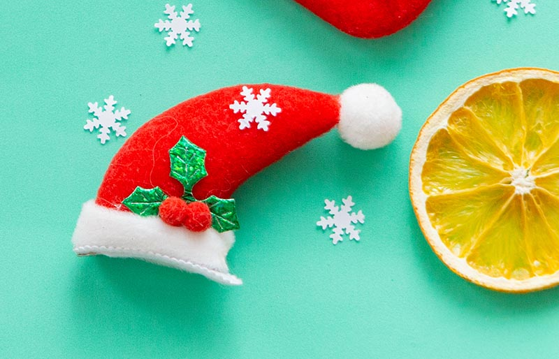 christmas flat lay on green background | christmas ornaments to sew