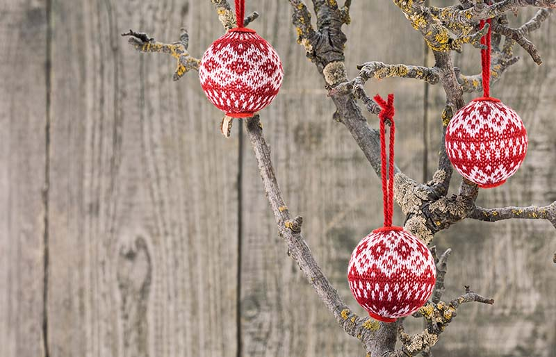 fabric christmas balls hanging on wooden | christmas ornaments to sew