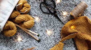 brown yarn on gray textile | Beginner Sewing Patterns You Can Do This Winter | Featured