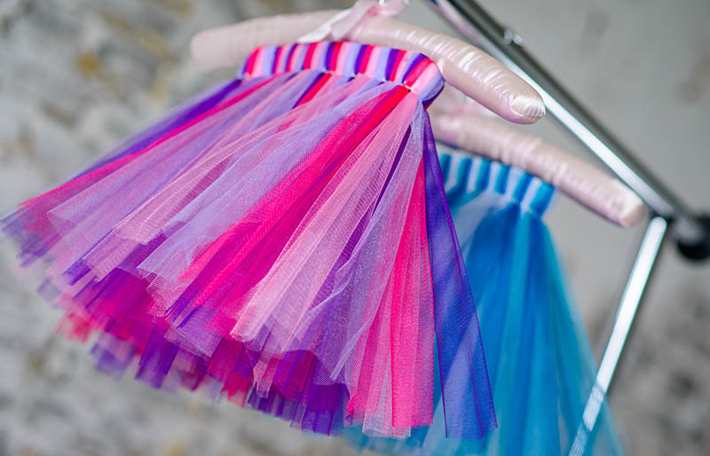 colored childrens skirt hanging on hanger baby | sewing for beginners