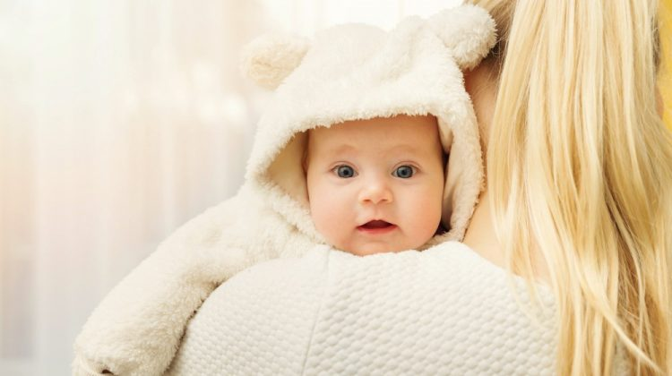 Mother with her baby in fluffy bear costume over shoulder | Easy Baby Winter Clothes You Can Sew Over The Weekend | cheap baby clothes | Featured