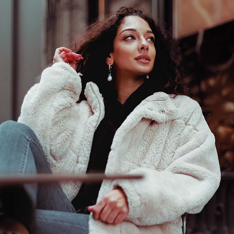woman in white fur coat | sewing for beginners