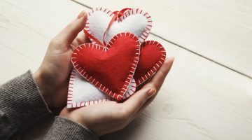 sewed pillow diy handmade hearts in woman's hands | Valentine's Day Gift Ideas For Sewing Junkies | valentines day gift ideas | best valentines gift for her | Featured