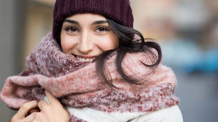 closeup face young happy woman enjoying | How to Make a Fleece Scarf | Featured