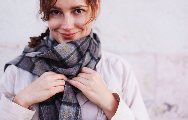 pretty woman wearing warm scarf | how to make a fleece scarf