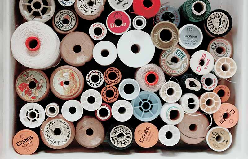assorted color threads   diy sewing room organization ideas
