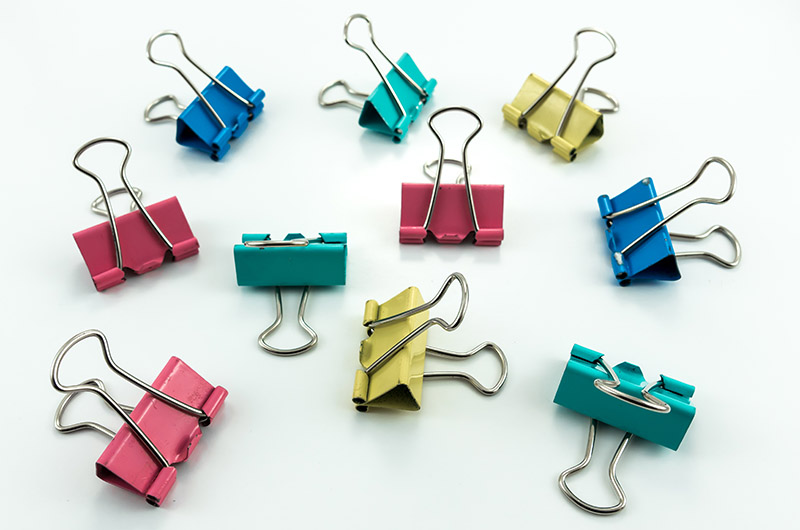 colorful multi color binder clips isolate | diy sewing room organization ideas