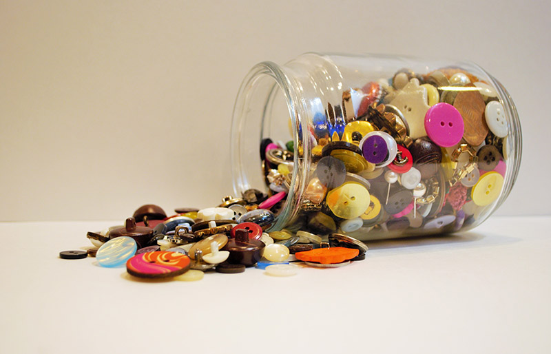 jar full multi colored buttons overflowing | diy sewing room organization ideas