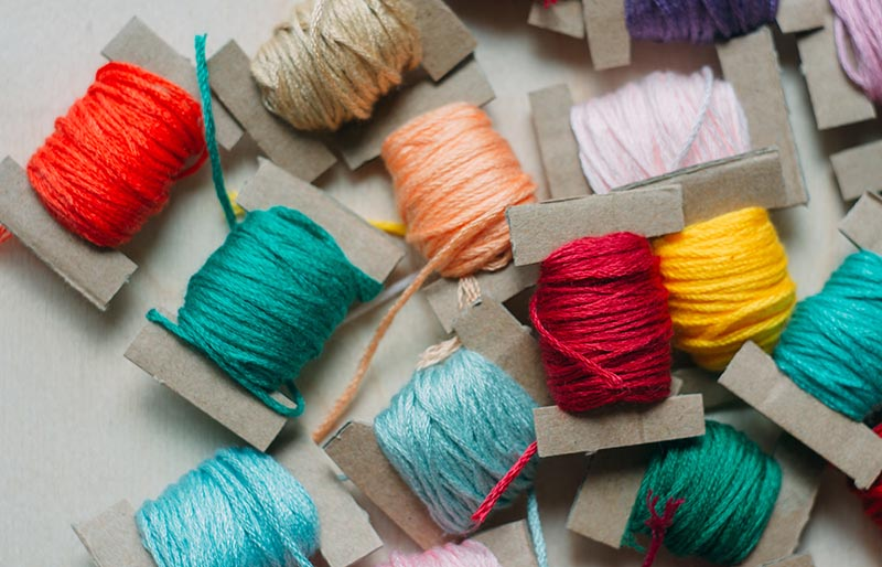 multicolor thread on cardboard embroidery floss | diy sewing room organization ideas
