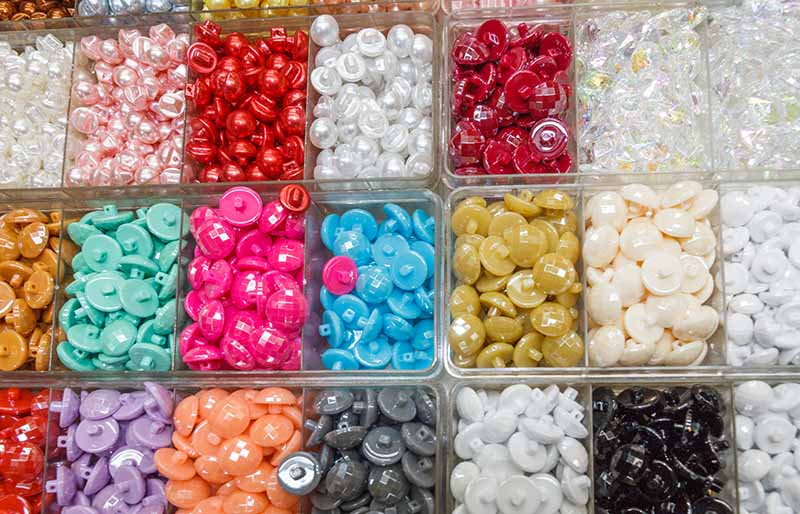 trays coloured buttons | diy sewing room organization ideas