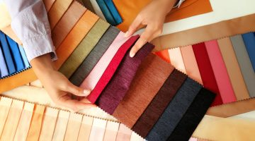 Young woman with fabric samples | Fabric Types | Everything You Need To Know | Sewing 101 | all about fabrics | Featured
