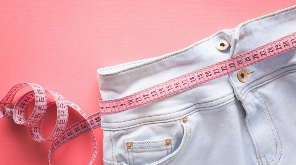measure tape light blue jeans   How To Alter Clothes That Are Big I Sewing Tips For Beginners