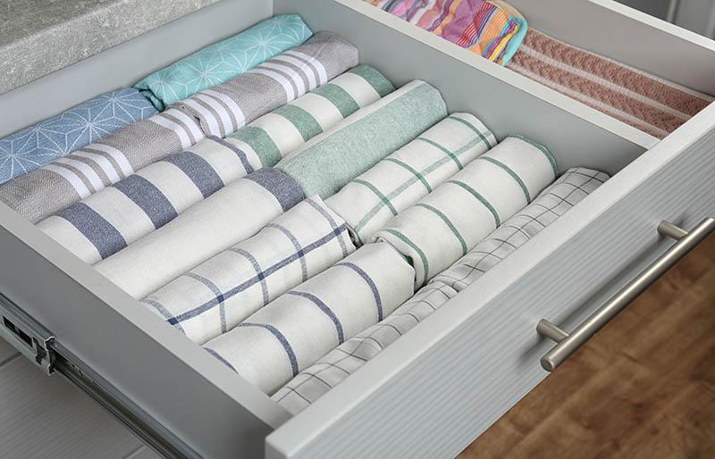 open drawer folded towels order kitchen | fabric stash management