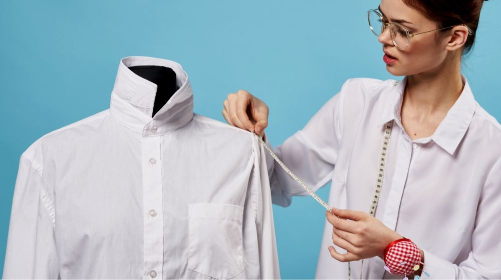 woman sewing designer mannequin shirt hobby   How To Alter Clothes That Are Big I Sewing Tips For Beginners