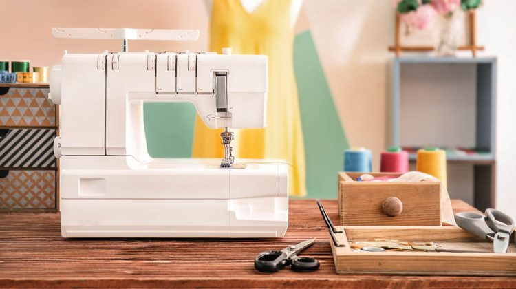 sewing machine on table tailors workshop | Dainty Sewing Table Ideas | Featured