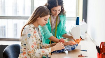 Pretty seamstress teaching girl working with sewing machine | Clever Sewing Projects To Upcycle Fabric Scraps | recycled fabric scraps | Featured