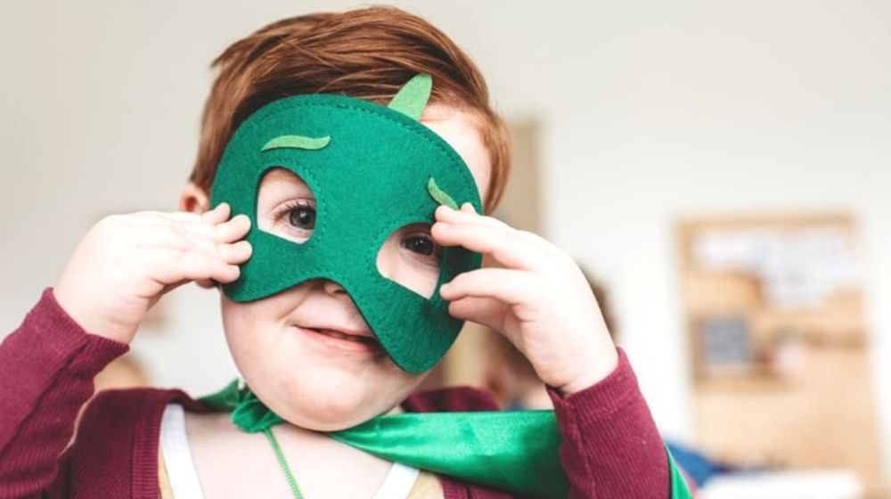 boy holding green mask | Fun Sewing Ideas For Moms and Kids