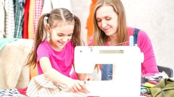 happy teacher teaches little girl sew | Fun Sewing Ideas For Moms and Kids | Featured