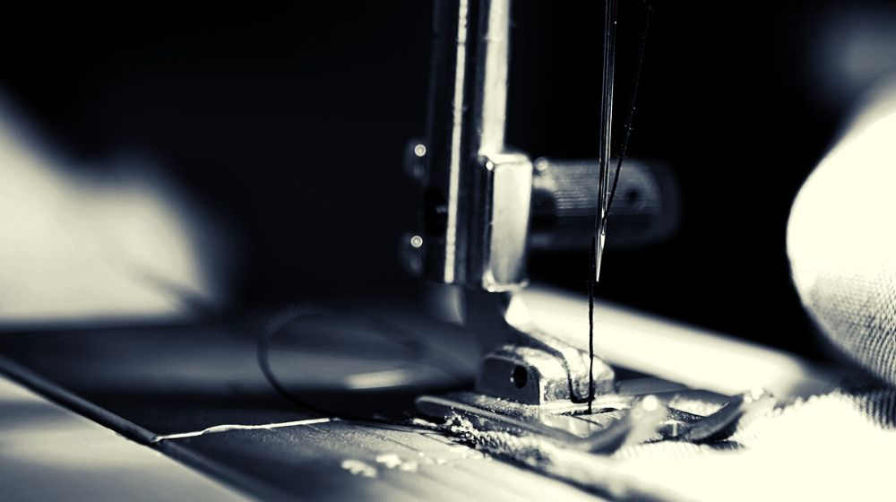 sewing machine grey scale photography and close up photography | Basic Sewing Machine Parts Every Beginner Should Know