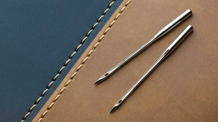 sewing machine needles leather on dark | Sewing 101 | The Basics of Sewing Leather | Featured