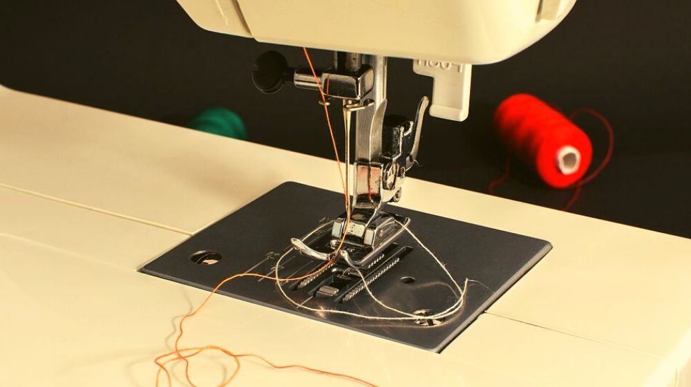 orange thread on a sewing machine | Free Online Sewing Classes You Can Take | sewing classes