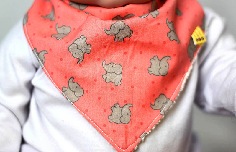 baby doll wearing bandana bib portrait | easy sewing projects for beginners