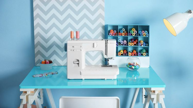 sewing machine fabric on table tailor | Space Saving Sewing Tables For Small Areas | Featured