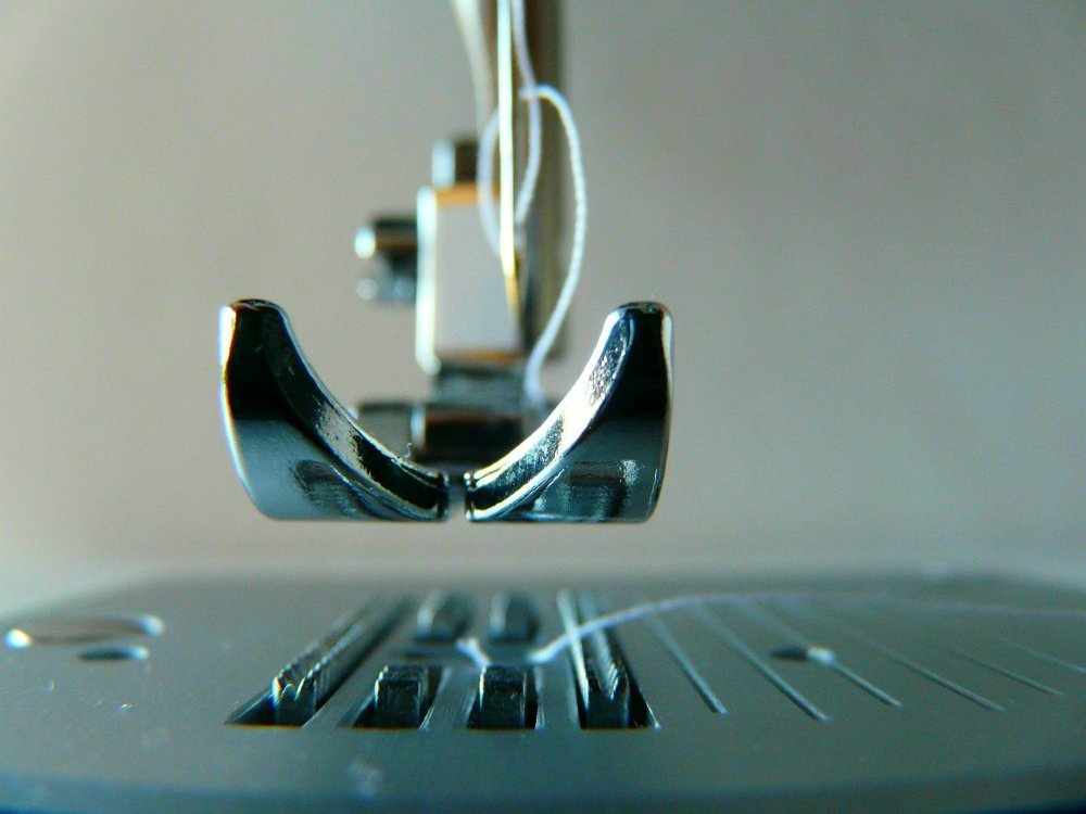 Closeup image of sewing machine needle and foot | What's The Difference Between Quilting Machines and Sewing Machines?