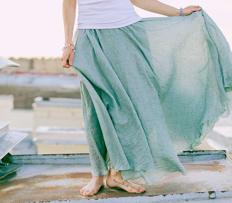 woman in white and green dress standing on dock | easy sewing projects for beginners