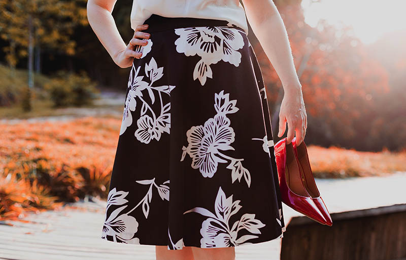 woman wearing skirt holding her shoes | easy sewing projects for beginners