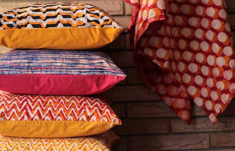 assorted color stack of pillows | easy sewing projects for beginners