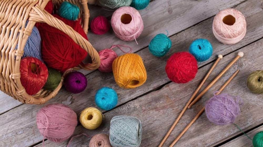 balls yarn scattered near basket | Embroidery Floss | A Guide to It's Types & Uses