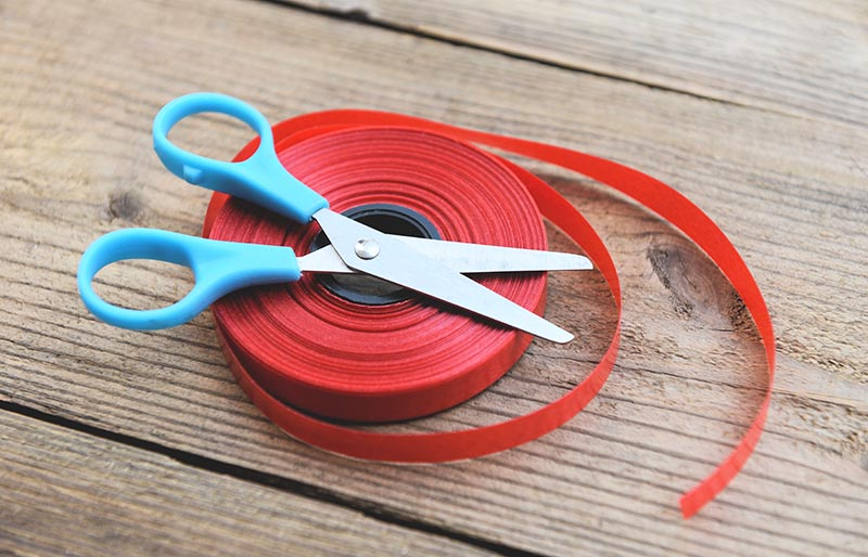 image photoroll red ribbon scissors on wooden | sewing hacks