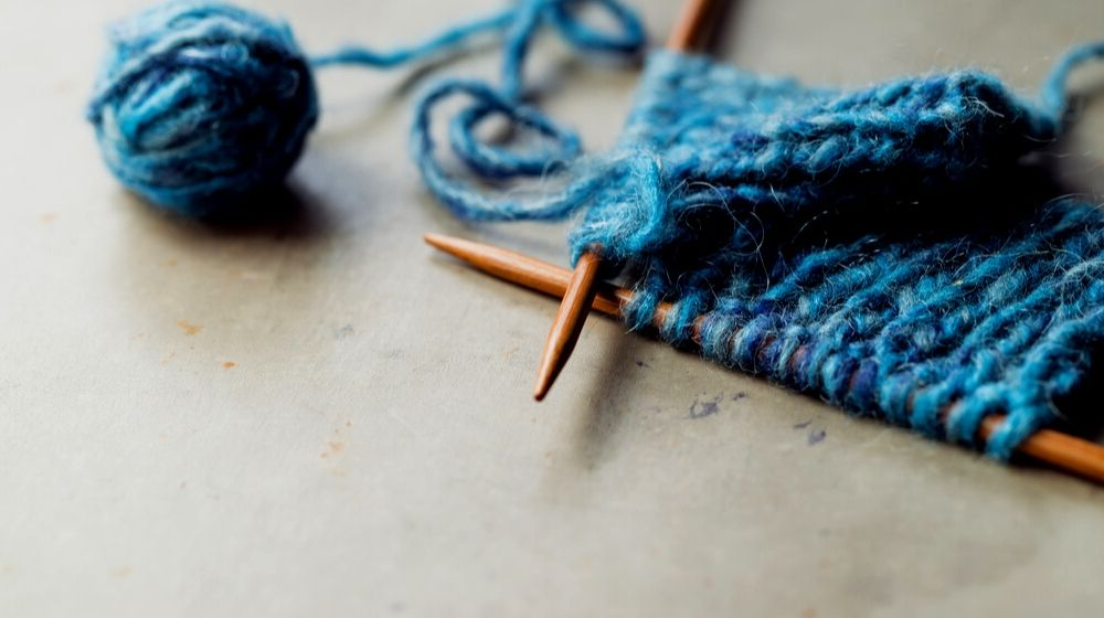 incomplete knitting project wooden needles | Embroidery Floss | A Guide to It's Types & Uses