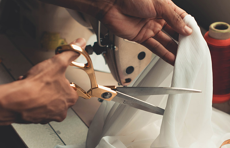 person cutting white cloth   sewing hacks