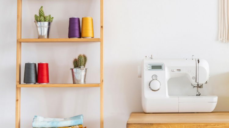 real photo sewing machine on desk | The Ultimate Sewing Cabinet Guide | Featured