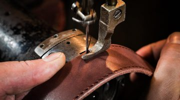 sewing process leather belt mans hands | What Is The Best Leather Sewing Machine For You | Featured