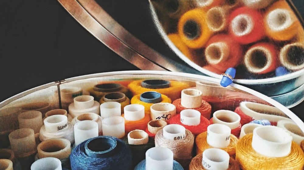 multicolored spools thread round tin box | Easy DIY Sewing Box Perfect For Travelling
