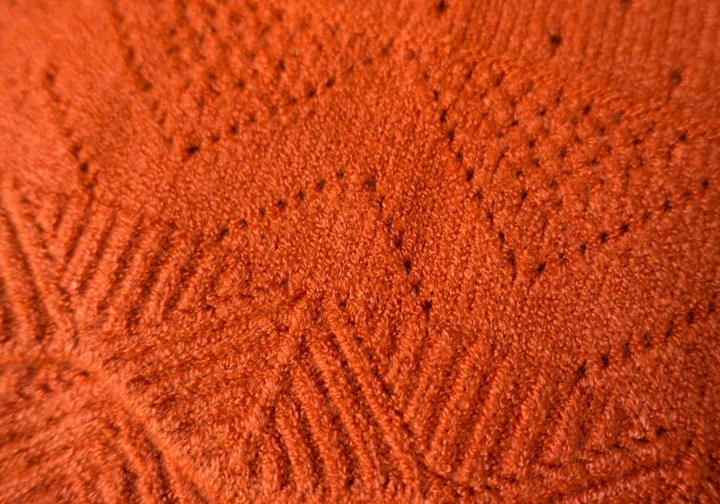 Cashmere fabric with geometric relief pattern and perforations | types of fabrics