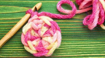 Warm pink winter yarn ball for knitting and crochet on the wooden table | How To Do A Magic Ring Crochet Perfectly | magic circle crochet | Featured