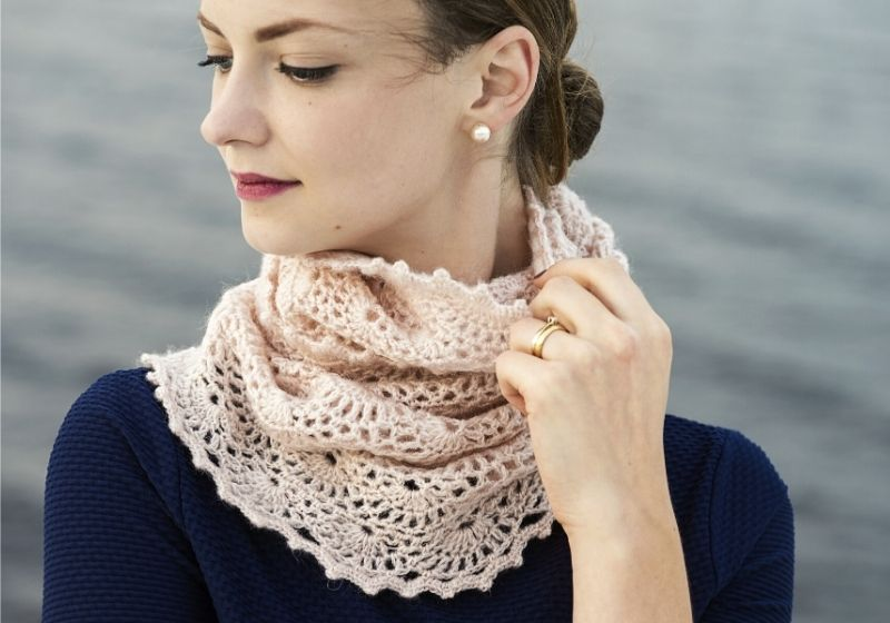 Young attractive woman wearing lacy crochet snood | infinity scarf crochet for beginners