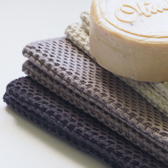 natural soap on towels on white background | Crochet Washcloth Patterns And Designs To Make Over The Weekend | how to crochet washcloth