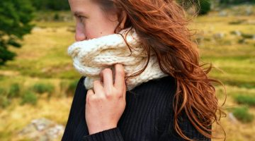woman wearing black sweater while facing her left side photo   ## Easy Infinity Scarf Crochet Ideas For The Cold Season   easy infinity scarf crochet pattern   featured
