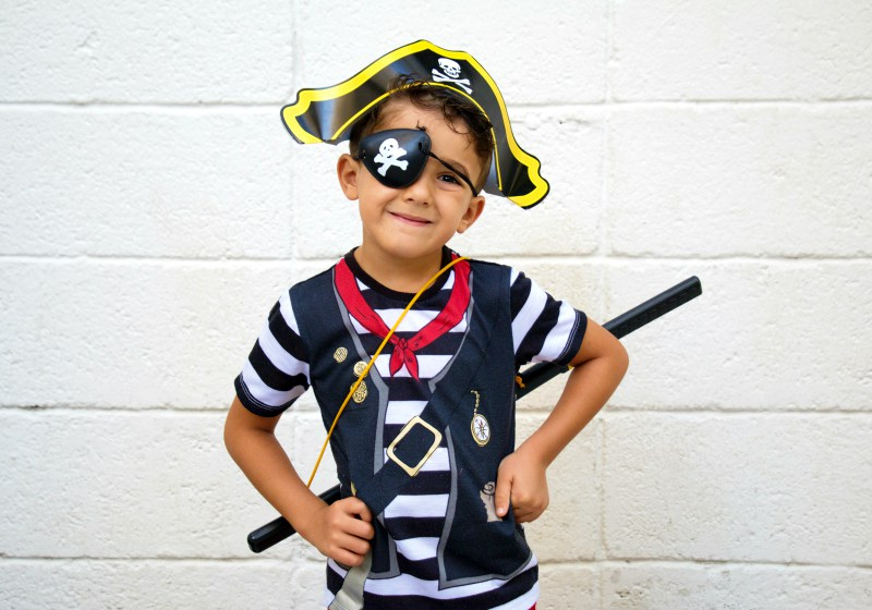 little pirate boy posing camera while | historical costume patterns free
