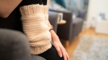 person wearing black socks   How To Sew Cozy Leg Warmers For You and Your Family   Featured